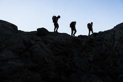 Three climbers traverse ridge, Darran Mountains, Fiordland National Park
