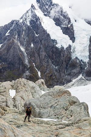 Climber with Mount Tutoko and Age Glacier behind, Fiordland National Park