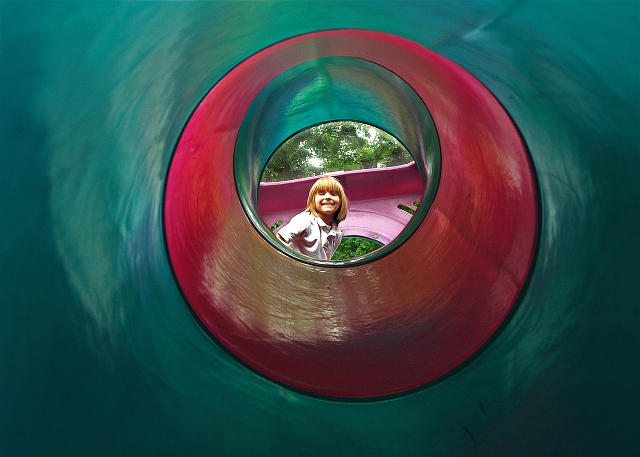 A girl looks down a tunnel