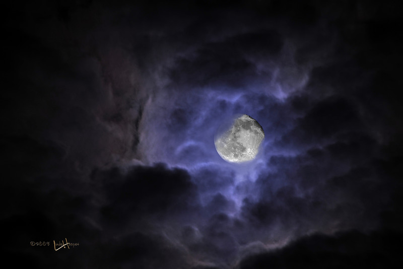 This October evening, the moon put on a show as the clouds rushed swiftly by. The clouds almost seem to form the shape of a hand and the moon is resting in the palm of the hand