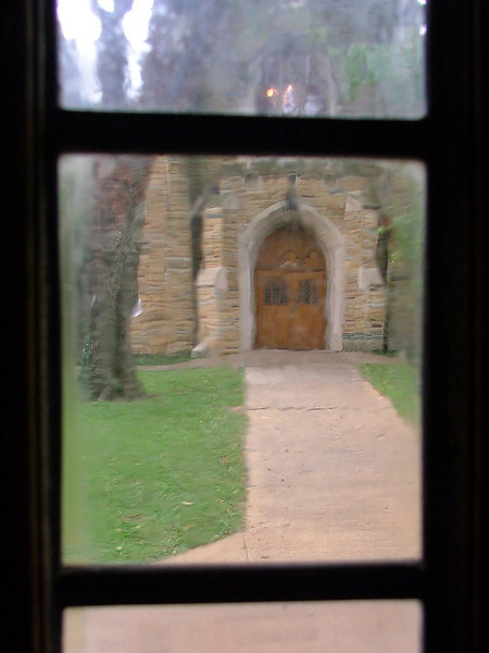 A view through an ancient window at an ancient entry