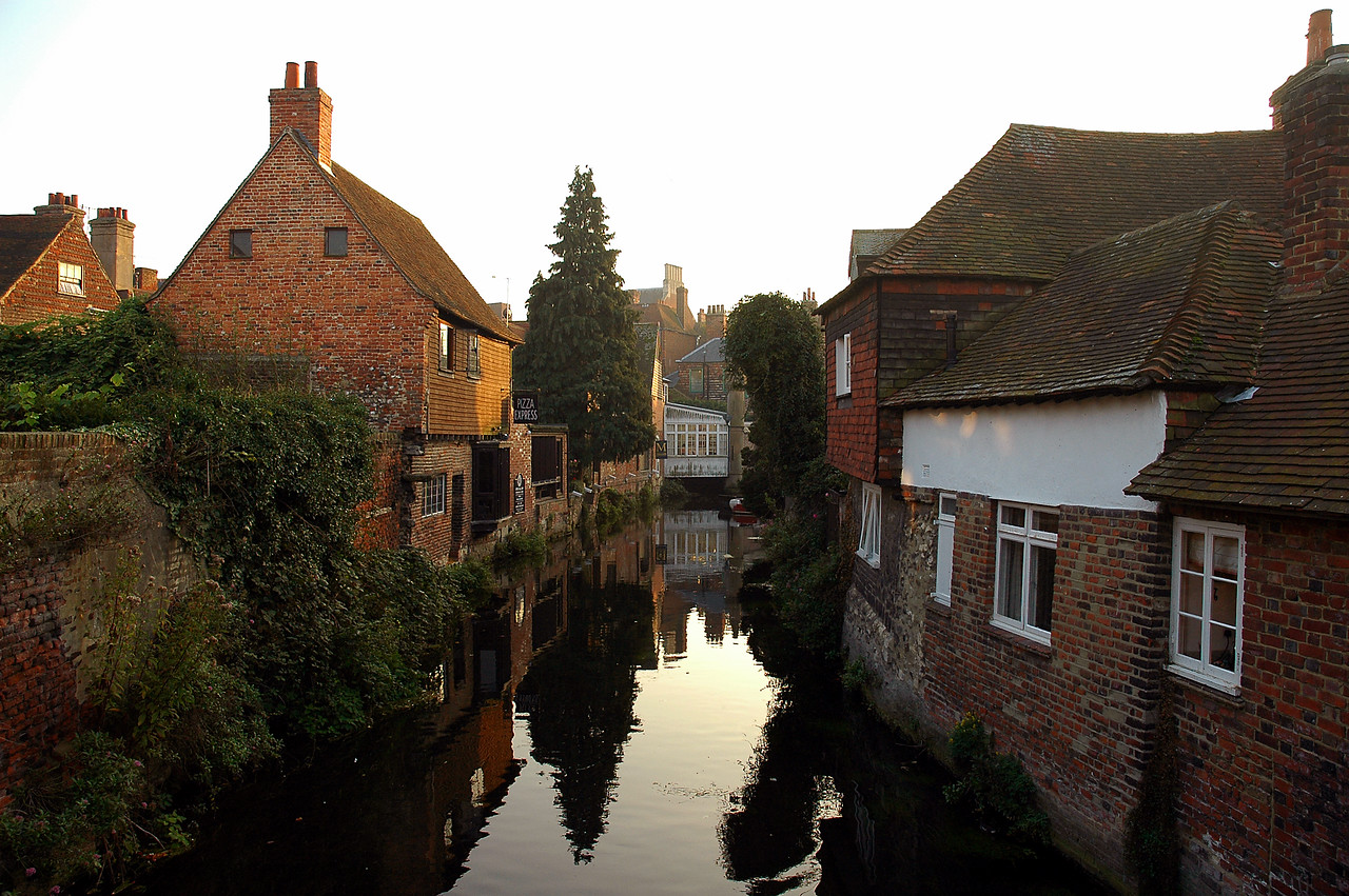 Canterbury, England has the most beautiful dwellings. Looking further down the canal you may be able to make out the sign for a pizza restaurant.