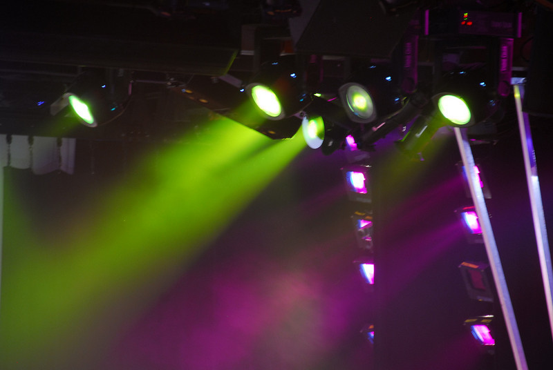The entertainer, stage lights and a smoke filled room
