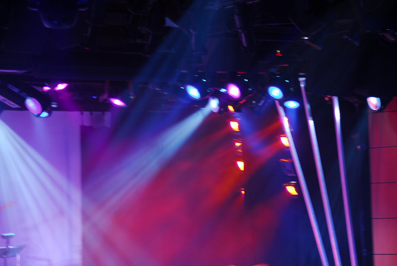 The entertainer, stage lights and a smoke filled room.