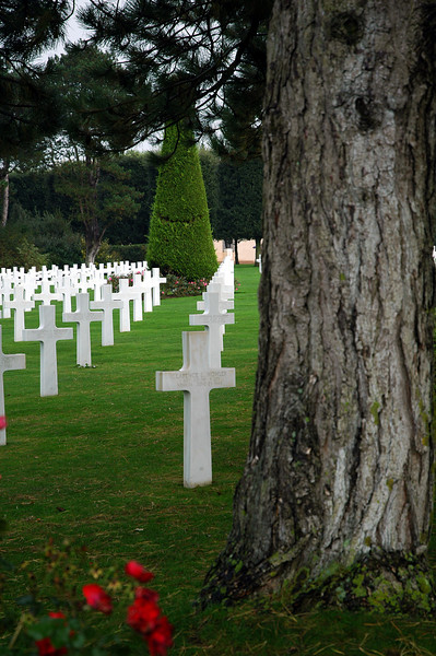 American cemetery at Omaha Beach in Normandy, France. There are 9,387 white crosses perfectly aligned on 170 acres of land by the beach where so many died fighting the battle of Normandy in 1944.<br /> <br /> For each cross, 9,387, there is a hero and countless other heroes returned to the shores of America after the war.<br /> <br /> Let us not forget<br /> Those who fought for Freedom in World War II and each war that followed.<br /> <br /> Let us not forget<br /> Those in the Armed Forces today, whether within the borders of this great land or in a remote area of the world in harms way.