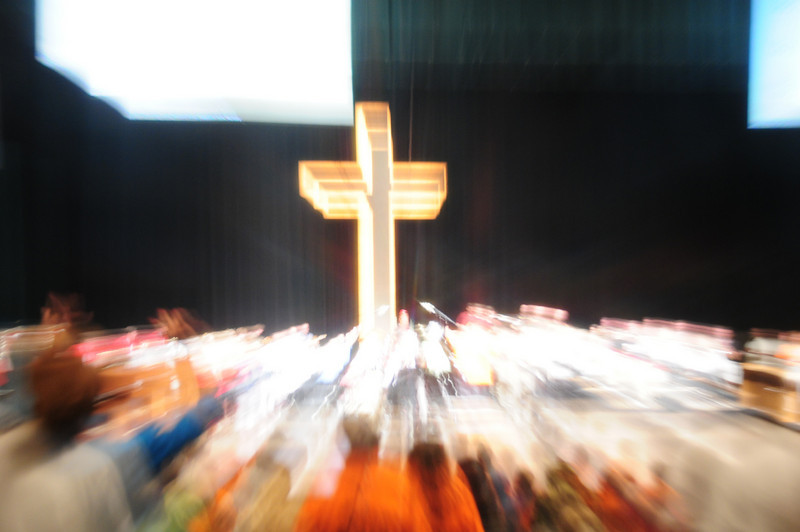 All stand at the foot of the cross and are drawn into the Priesthood of all believers.