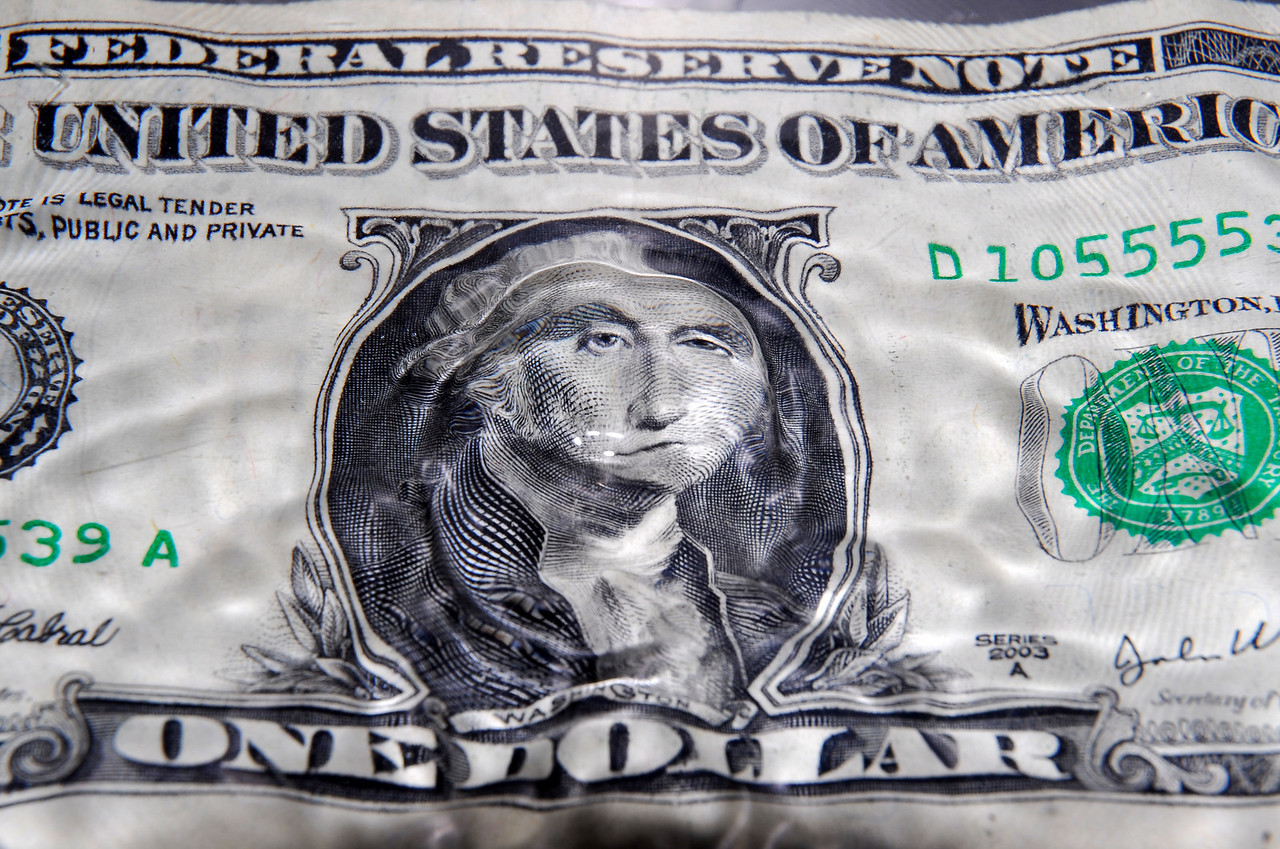 The ripples after a splash create the image of George Washington pondering the future on this one dollar photograph