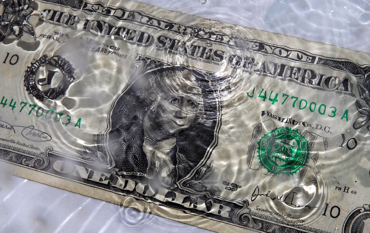 The ripples after a splash create the image of George Washington smiling on this one dollar photograph