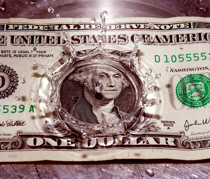 George Washington dollar bill splash... liquid assets?