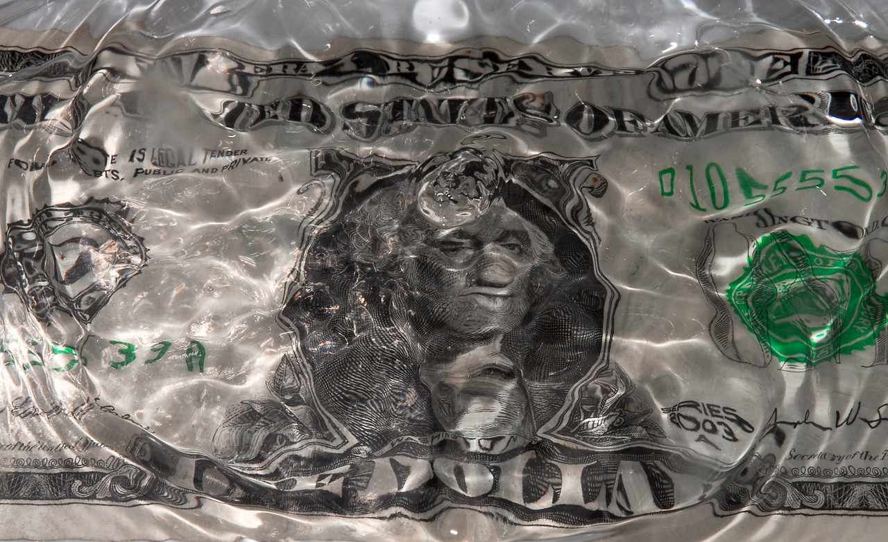 The ripples after a splash create the image of George Washington with a black eye and a big lip.