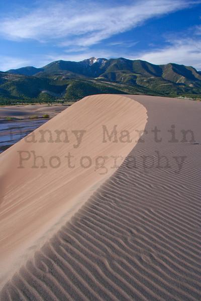 dune over the Sangre de Cristo range.  Great Sand Dunes National Park, CO.