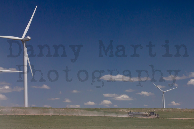 Wind Turbines and oil truck.<br /> Weld County, Colorado.