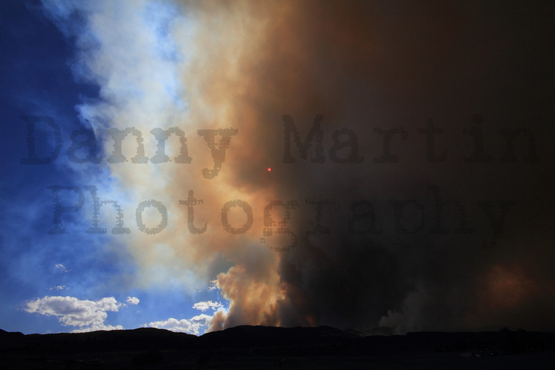 Sun peeking through smoke plume, High Park Fire near Lory State Park.  Horsetooth Reservoir, Ft. Collins, CO.