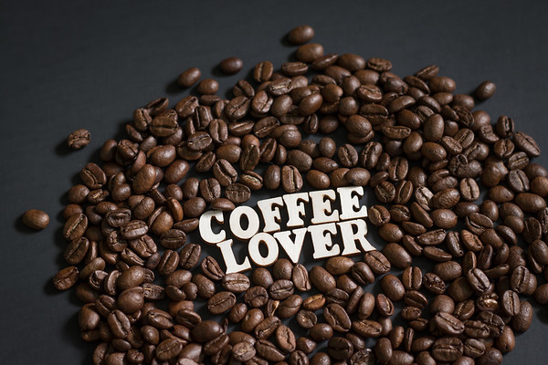 The Words Coffee Lover surrounded by Coffee Beans