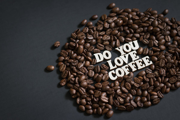 Do You Love coffee surrounded by coffee beans