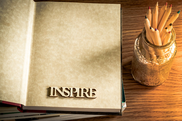 Inspire Text in a Book on a Desk