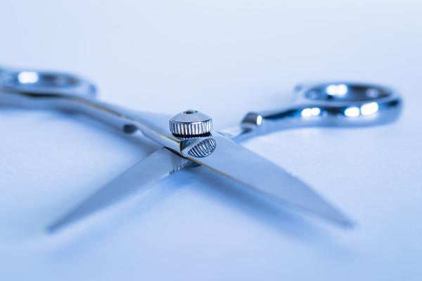 Hairdresser scissors on a white background