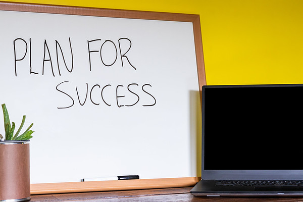 Professional Business Desk with Whiteboard and Text Plan For Success