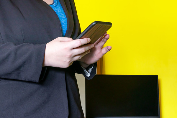 Businesswoman Typing on a Cellphone