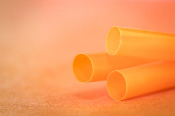 Orange Straws on an Orange Background