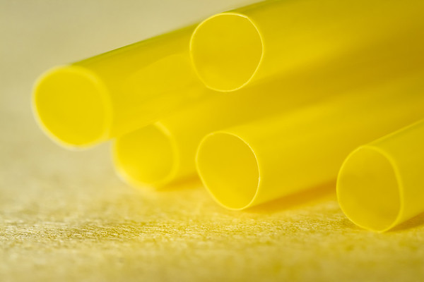 Yellow Straws on an Yellow Background