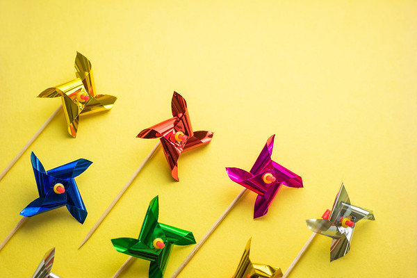 Colorful Pinwheels on a Yellow Background