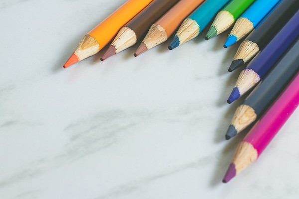 Colored Pencils on a White Marble Background