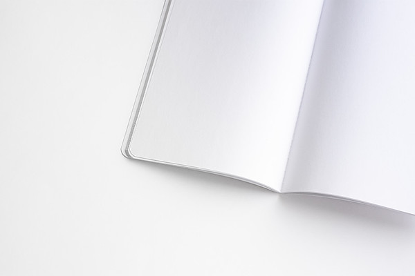 White Open Notebook on a White Background