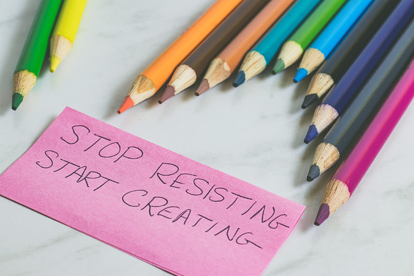 Colored Pencils and Text on a White Marble Background