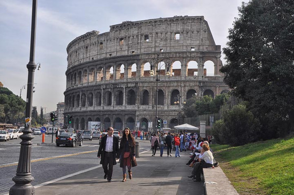 pedestrians in front of the Colosseum, Rome, Italy