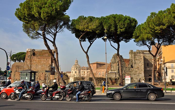 navigating Rome. part of the Imperial Forum in the background, Italy