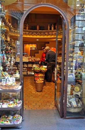shopkeeper and customer, Taomina, Sicily, Italy
