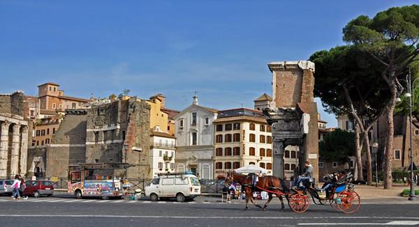 carriage rides along Via dei Fori Imperiali next to the Roman Forum