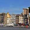 carriage rides along Via dei Fori Imperiali next to the Roman Forum