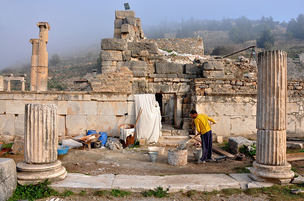 Repairing the Roman ruins at Ephesus, Turkey. Morning fog lends a mysterious allure to the ruins.
