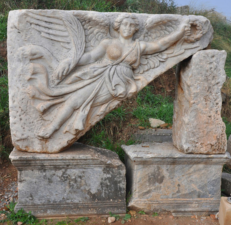 The Roman ruins at Ephesus, Turkey 163. Relief of the flying Nike, goddess of Victory and messenger of Zeus. She holds a crown of laurels and a bundle of ears of corn.