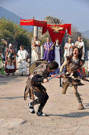 The Roman ruins at Ephesus, Turkey 274. Gladiators fight while other re-enactors watch.