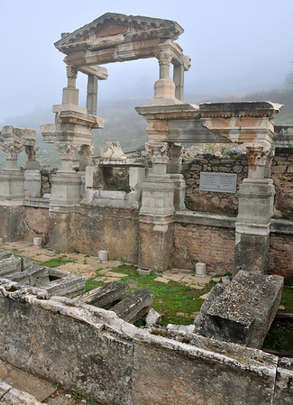 The Roman ruins at Ephesus, Turkey. Fountain of Trajan, once housed a 20 x 10m pool surrounded by columns and statues of Dionysus, Satyr, Aphrodite and the family of Emperor Trajan.