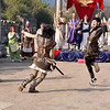 The Roman ruins at Ephesus, Turkey. Gladiators fight while other re-enactors watch.