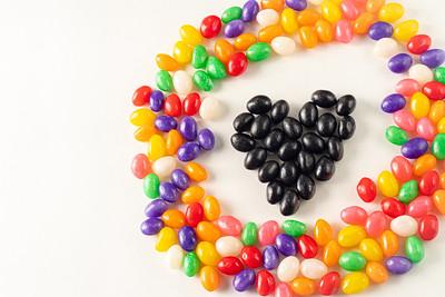 Creative Black Jellybean Heart in the Center of a  Colorful Jellybean Circle