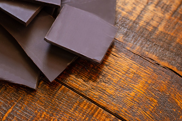 Overhead Angle of Dark Chocolate on a Wooden Table