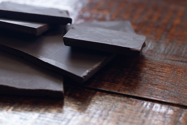 Moody Closeup Shot of Dark Chocolate on a Brown Wooden Table