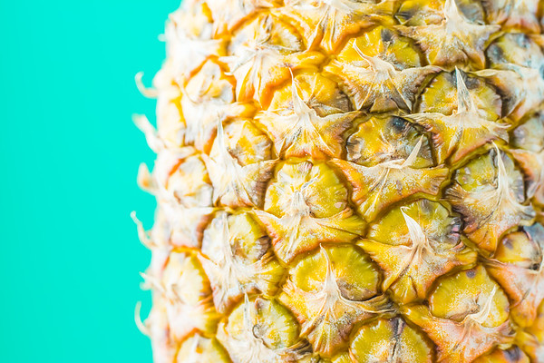 Pineapple Against a Blue Background
