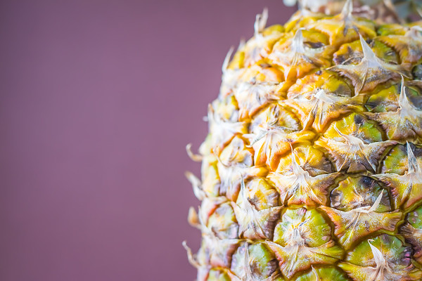 Pineapple Against a Purple Background