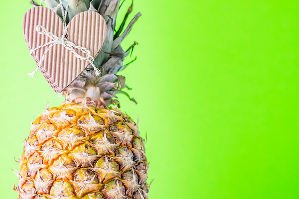 Pineapple Against a Green Background