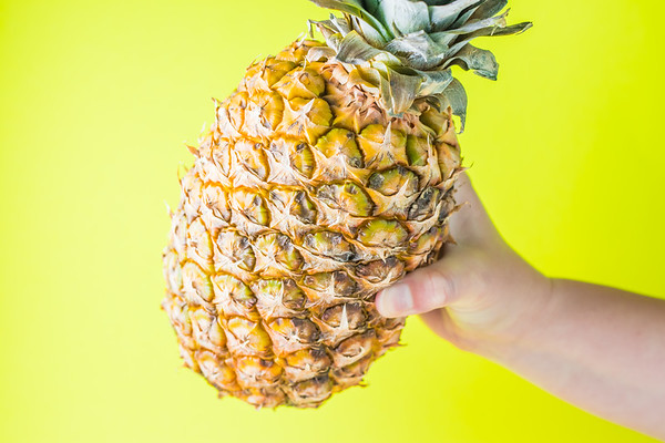 Pineapple Against a Yellow Background