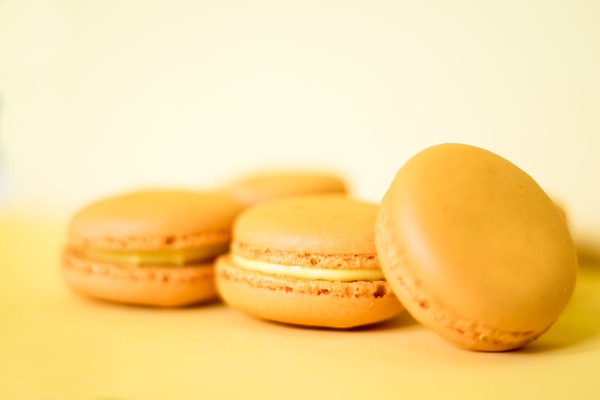 Yellow macaroons on a yellow background