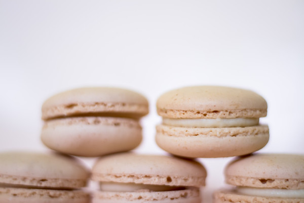 White macaroons on a white background