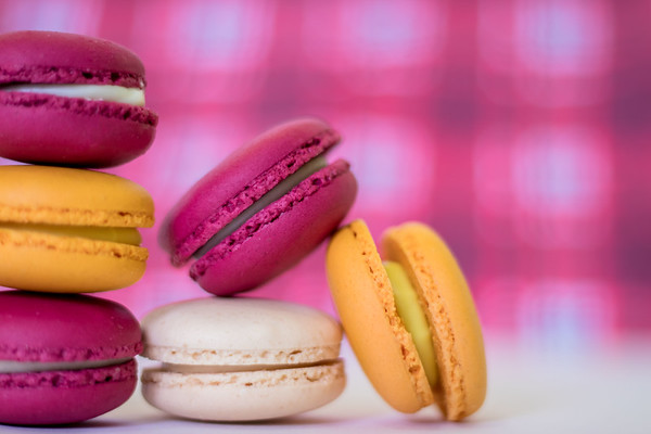 Colorful macaroons on a pink background