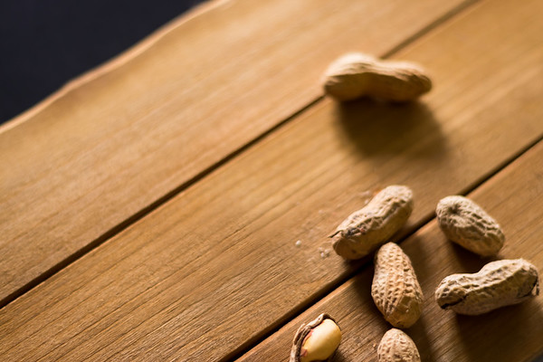 Overhead Peanuts on a Wooden Background